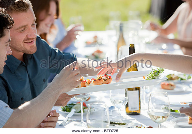 People at outdoor dinner party - Stock Image