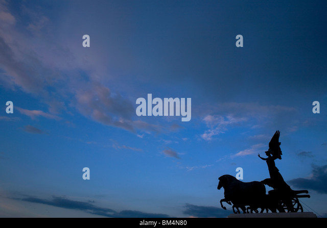 A statue of a Quadriga, or charriot, at the National Monument of Victor Emmanuel II in Rome, March 8, 2008. Photo/Chico - Stock Image