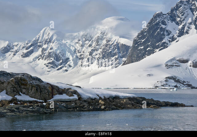 Snow covered mountain landscape - Stock Image