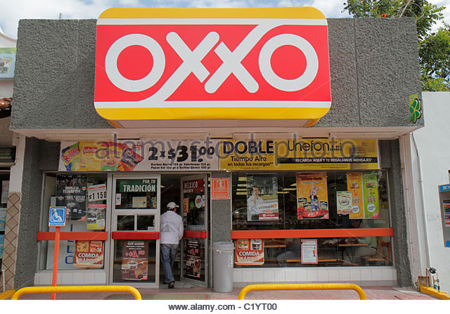 Cancun Mexico Yucatán Peninsula Quintana Roo Avenida Tulum Oxxo franchise chain convenience store grocer retail - Stock Image