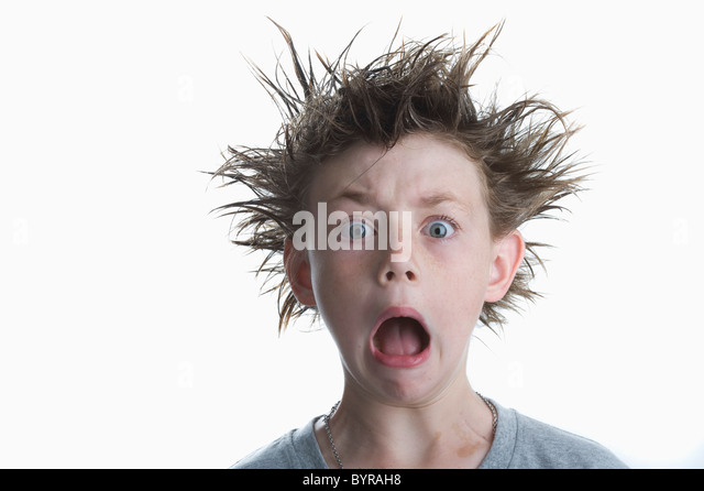boy with crazy hair - Stock Image