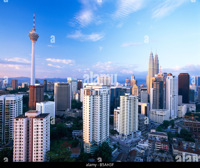 The city skyline including the twin towers of the Petronas Building Kuala Lumpur Malaysia Southeast Asia Asia - Stock Image