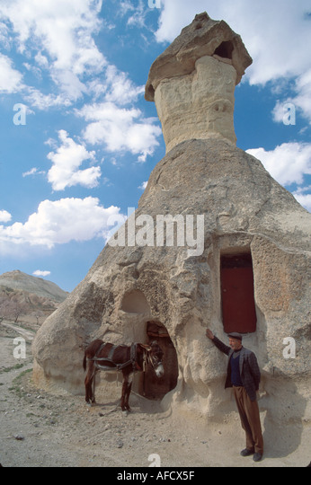 Turkey Cappadocia Zelve Valley fairy chimney volcanic tufa formation mule carved dwelling - Stock Image