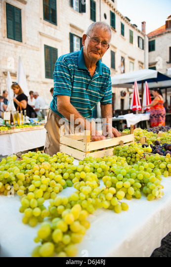 Vendor at Dubrovnik Market setting up his stall for Gundulic fruit market in Gundulic Square, Dubrovnik, Croatia, - Stock Image