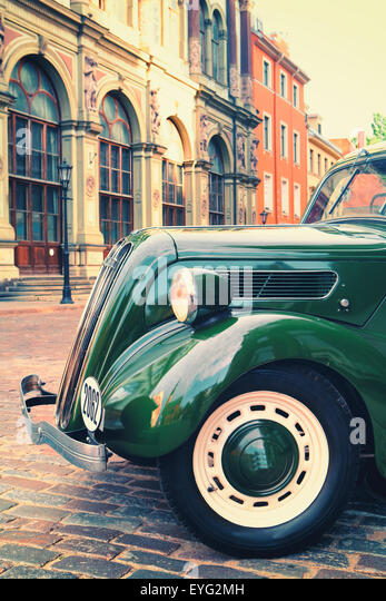 Latvia. Retro car on the street in the center of the old town of Riga with beautiful façades of medieval houses - Stock Image