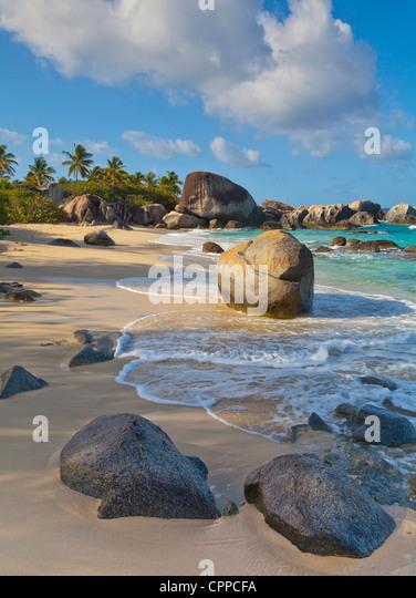 Virgin Gorda, British Virgin Islands, Caribbean Morning sun dappling the the surf and rock patterns at Little Trunk - Stock Image
