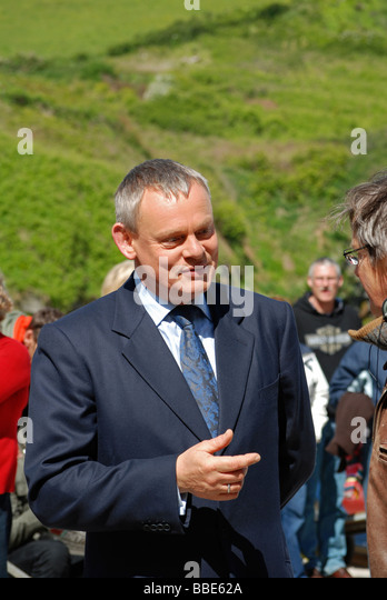 british actor Martin Clunes chats during a break in filming at port isaac in cornwall of the television series 'Doc - Stock Image