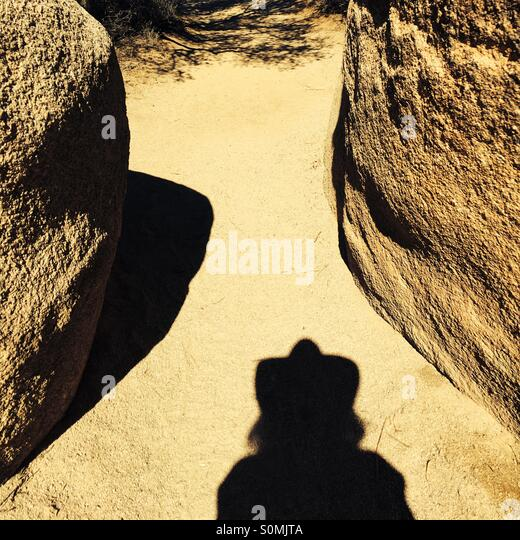 My shadow hiking in the Mohave Desert in San Bernardino County, California USA - Stock Image