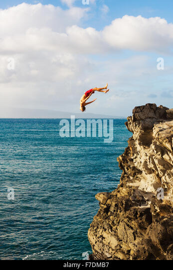Cliff Jumping into the Ocean at Sunset, Summer Fun Lifestyle - Stock-Bilder