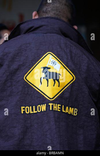 Follow the lamb on a Catholic's jacket, Sydney, New South Wales, Australia - Stock-Bilder
