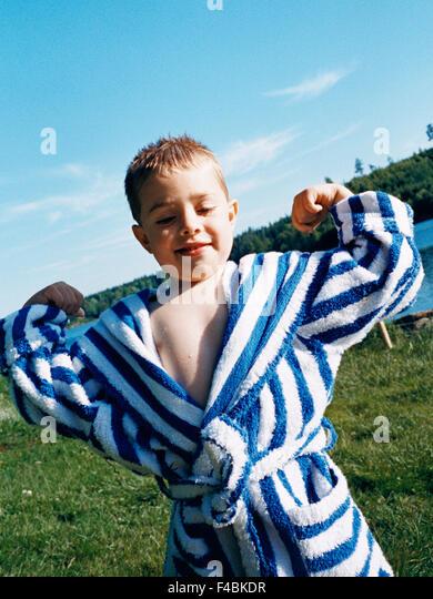 bathrobe body language boys color image one person only outdoors Scandinavia strength summer Sweden - Stock-Bilder