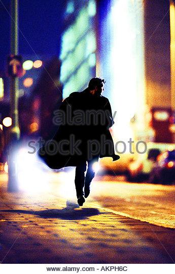 man running in the street - Stock-Bilder