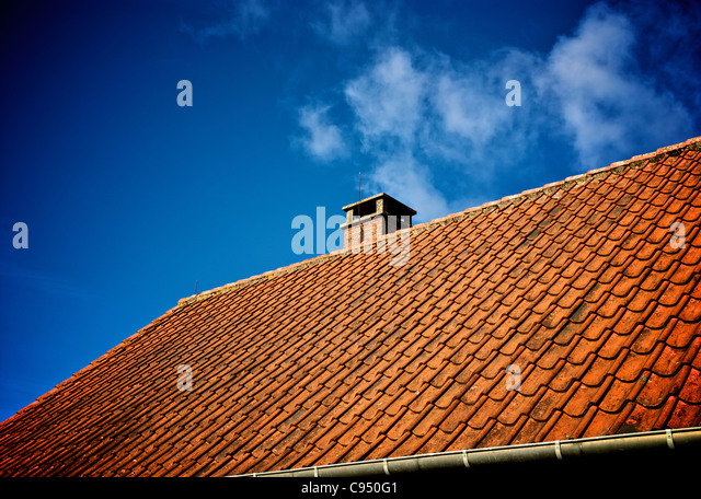 OLD ROOF WITH CHIMNEY - Stock Image