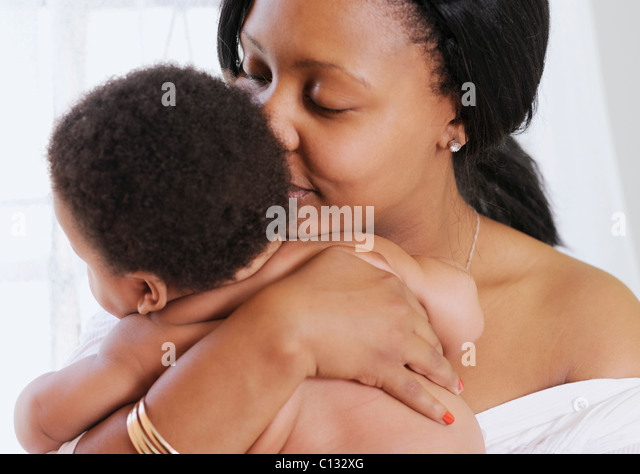 Mother hugging her baby. Cape Town, South Africa - Stock Image