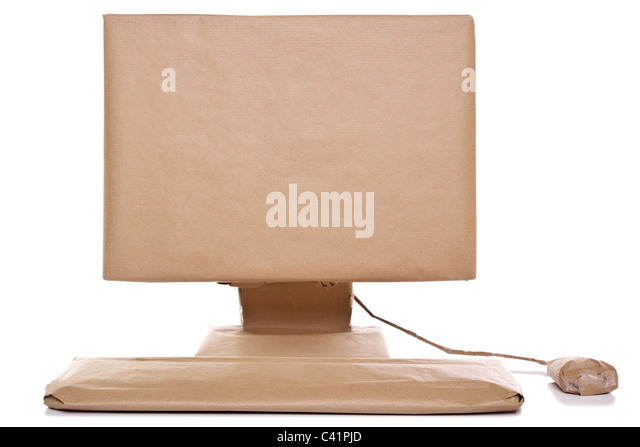 Photo of a computer wrapped in recycled brown paper, isolated on a white background. - Stock Image