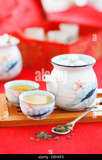 Green tea in a porcelain service - Stock Image
