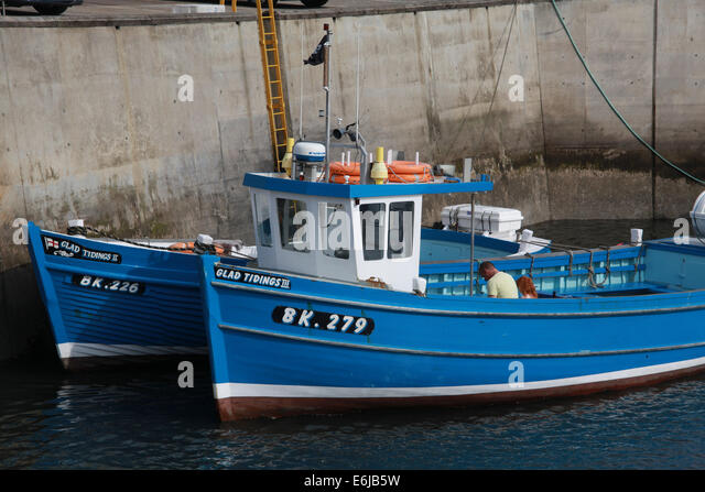 BK279 blue fishing boat at Seahouses harbour , Northumberland, NE England, Great Britain, UK - Stock Image