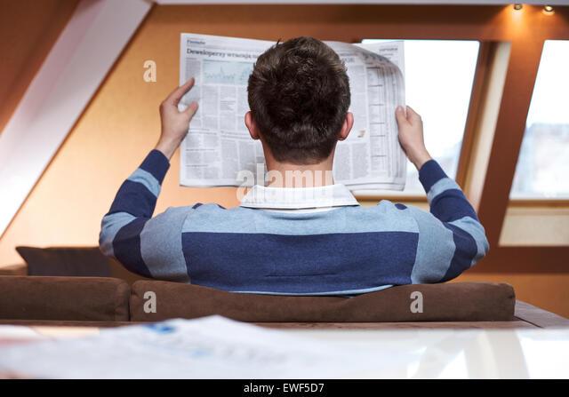 Man reading newspaper - Stock Image