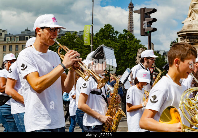 Paris, France. 24th Jun, 2017. Marching band playing during the Paris Olympic Games 2024 showcase. Credit: Guillaume - Stock Image