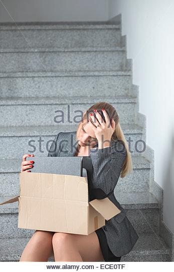 Woman depressed sad unemployed alone worried - Stock Image