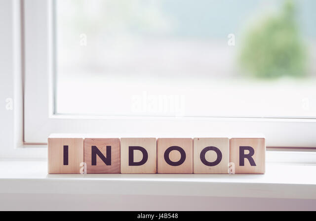 Indoor sign made of wooden cubes in a bright room - Stock Image