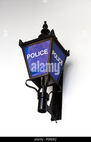 A traditional British police lamp pictured against a white background - Stock Image