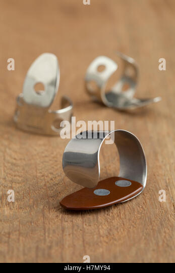 Banjo finger picks close up - Stock Image