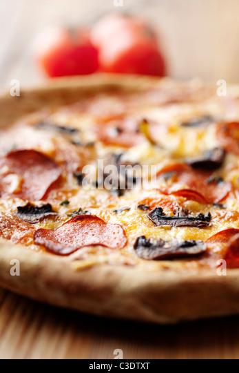 pepperoni and mushroom pizza - Stock Image