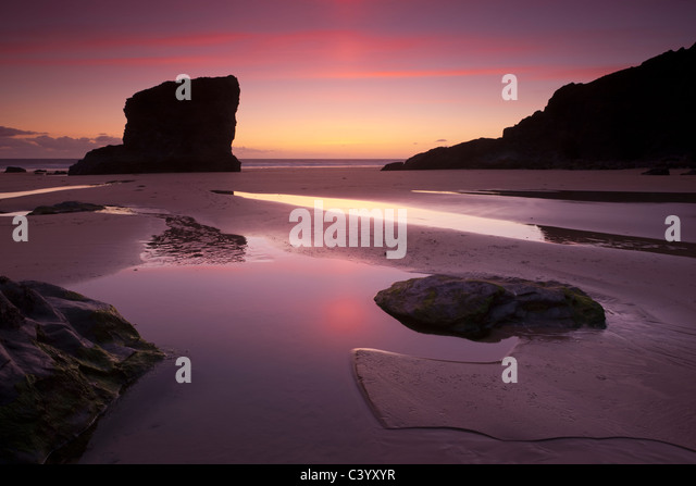 Twilight on the sandy beach at Bedruthan Steps, North Cornwall, England. Spring (May) 2011. - Stock Image