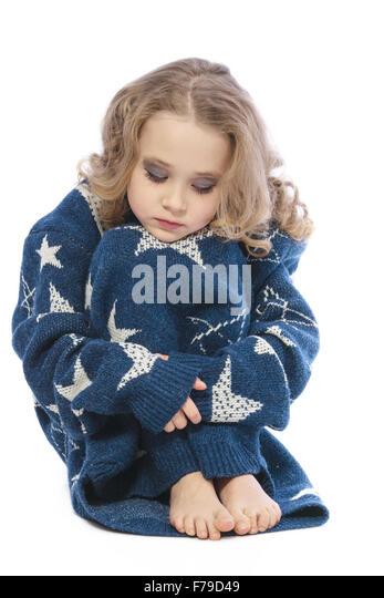 Girl in mom's sweater. - Stock Image