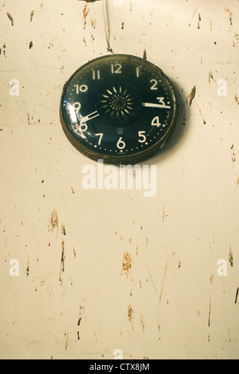 an antique clock on dirty wall, photo is taken at Penang, Malaysia. - Stock-Bilder