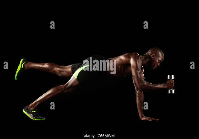 Athlete lifting weights - Stock Image