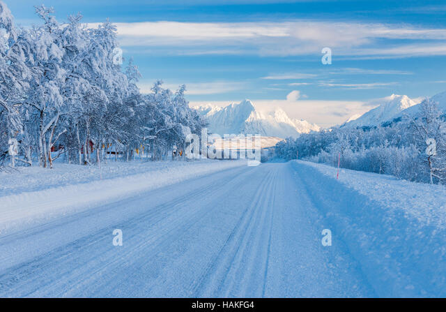 Snowy Road in Winter, Breivikeidet, Troms, Norway - Stock Image