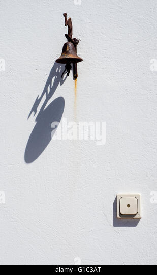 Bell and switch on White Wall, Lanzarote, Canary Islands, Spain - Stock-Bilder