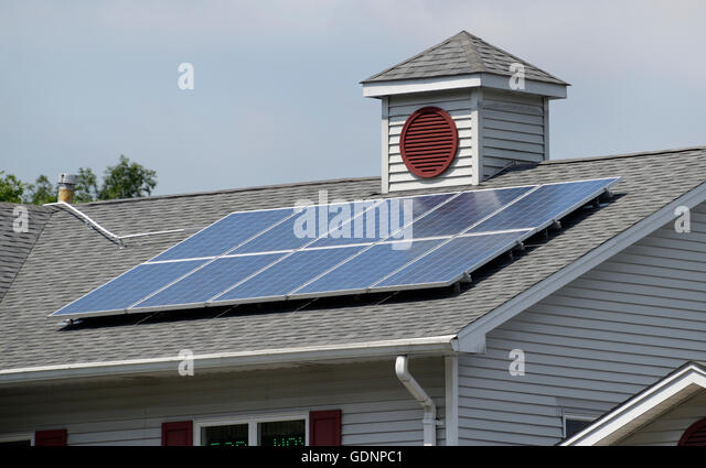 Solar panels on roof of a building, northern NJ - Stock Image