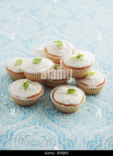 Cupcakes with white icing and lime, close-up - Stock Image