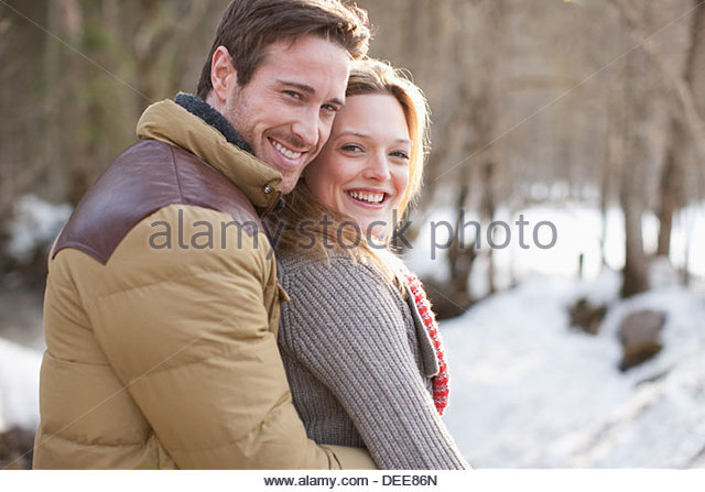 Portrait of smiling couple outdoors - Stock Image