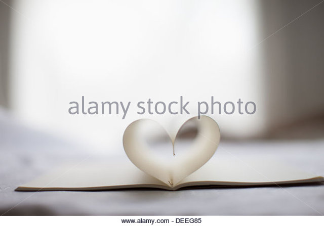 pages of notebook form heart-shape - Stock Image