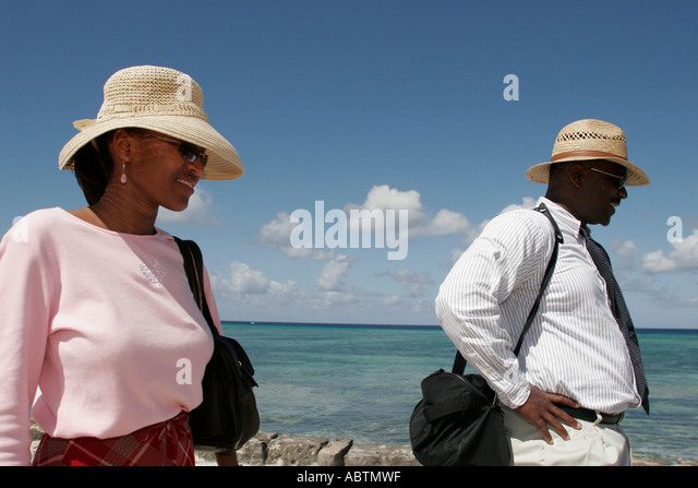 Grand Turk Cockburn Town Front Street Black couple man woman Turks Island Passage ocean - Stock Image