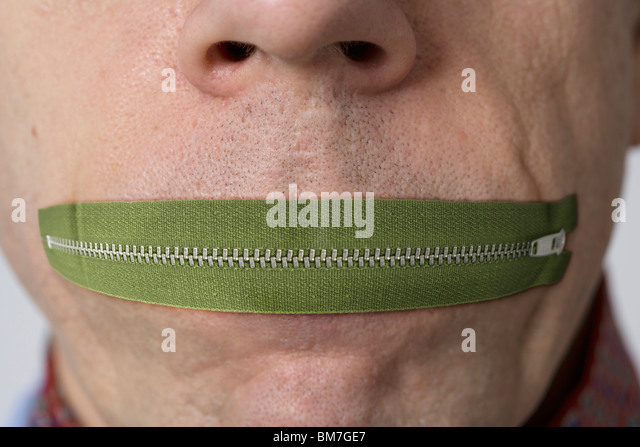 Zip your lip - Stock Image