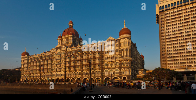 The Taj Mahal Palace Hotel in Mumbai Bombay India at sunrise with a crew of Bollywood  movie makers - Stock Image