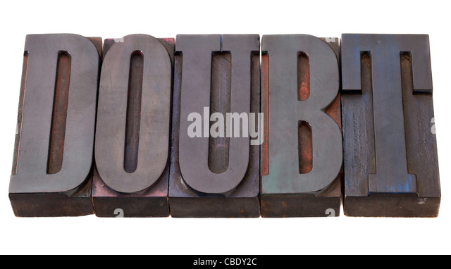 doubt - word in vintage wooden letterpress printing blocks, stained by color inks, isolated on white - Stock Image