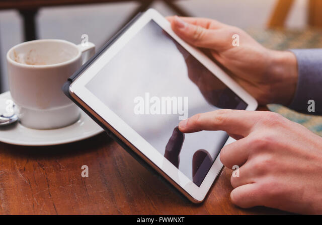 using internet on tablet in cafe, checking email and social networks on touchpad, closeup of finger - Stock-Bilder