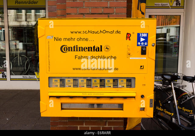 """Continental"" Vending machine for bicycle inner tubes, Bremen, Germany - Stock Image"