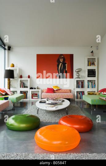 Brightly coloured zanotta pouffes in contemporary London apartment - Stock Image