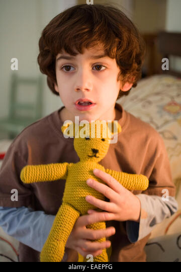 Young boy holding teddy bear - Stock Image