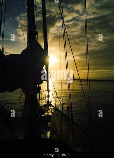 Sunrise from a yacht leaving St Peter Port Guernsey - Stock Image