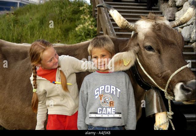 Switzerland Children cow boy girl country - Stock Image