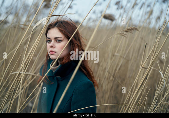 Portrait of serious Caucasian woman standing in field - Stock Image
