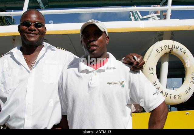 Sint Maarten Simpson Bay Lagoon Dutch Black male tour boat crew Explorer - Stock Image